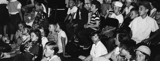 Children seated in a City of Winnipeg Community Centre for a recreation program event, circa 1965