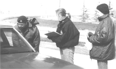 A picture of staff checking cars of people returning home. City of Winnipeg Photo