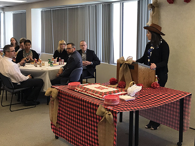 Amy Samphir thanks guest trainers during a western-themed appreciation lunch.