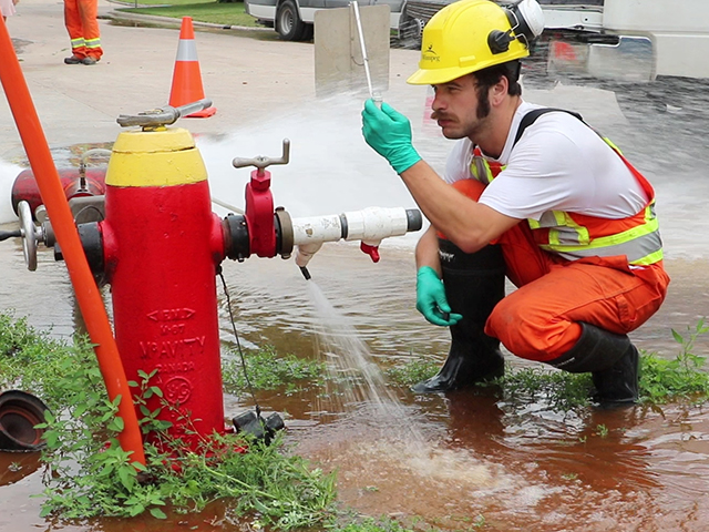 Crews take samples to test the water during the process.