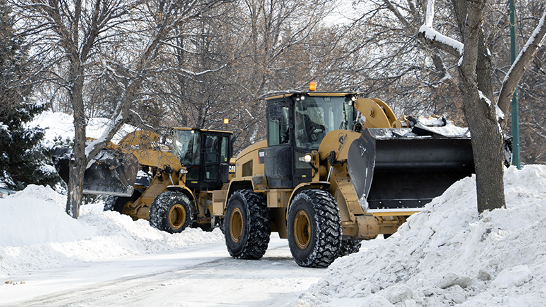 Snow clearing crews clear a residential street in Winnipeg.