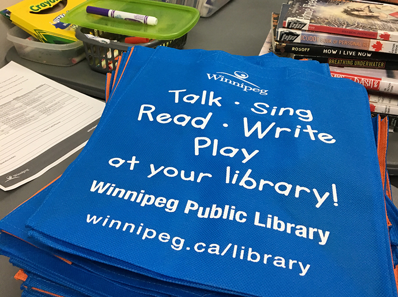 Winnipeg Public Library's Outreach Services Team prepared reading kits.