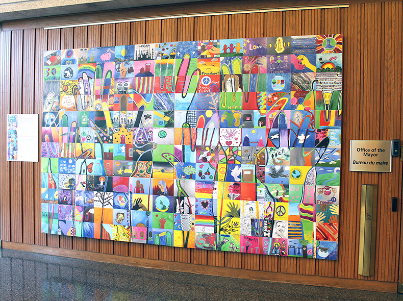 Human rights mural created by students now on display at City Hall
