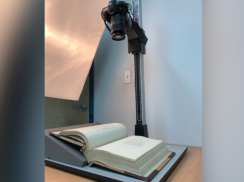 Camera above a book which is laying open on a table