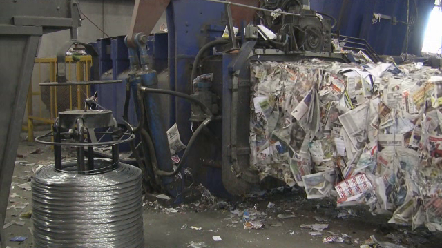 Paper being baled at the Materials Recovery Facility